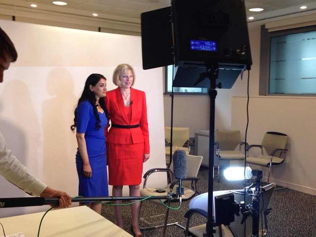 Aneeta with Theresa May being recorded